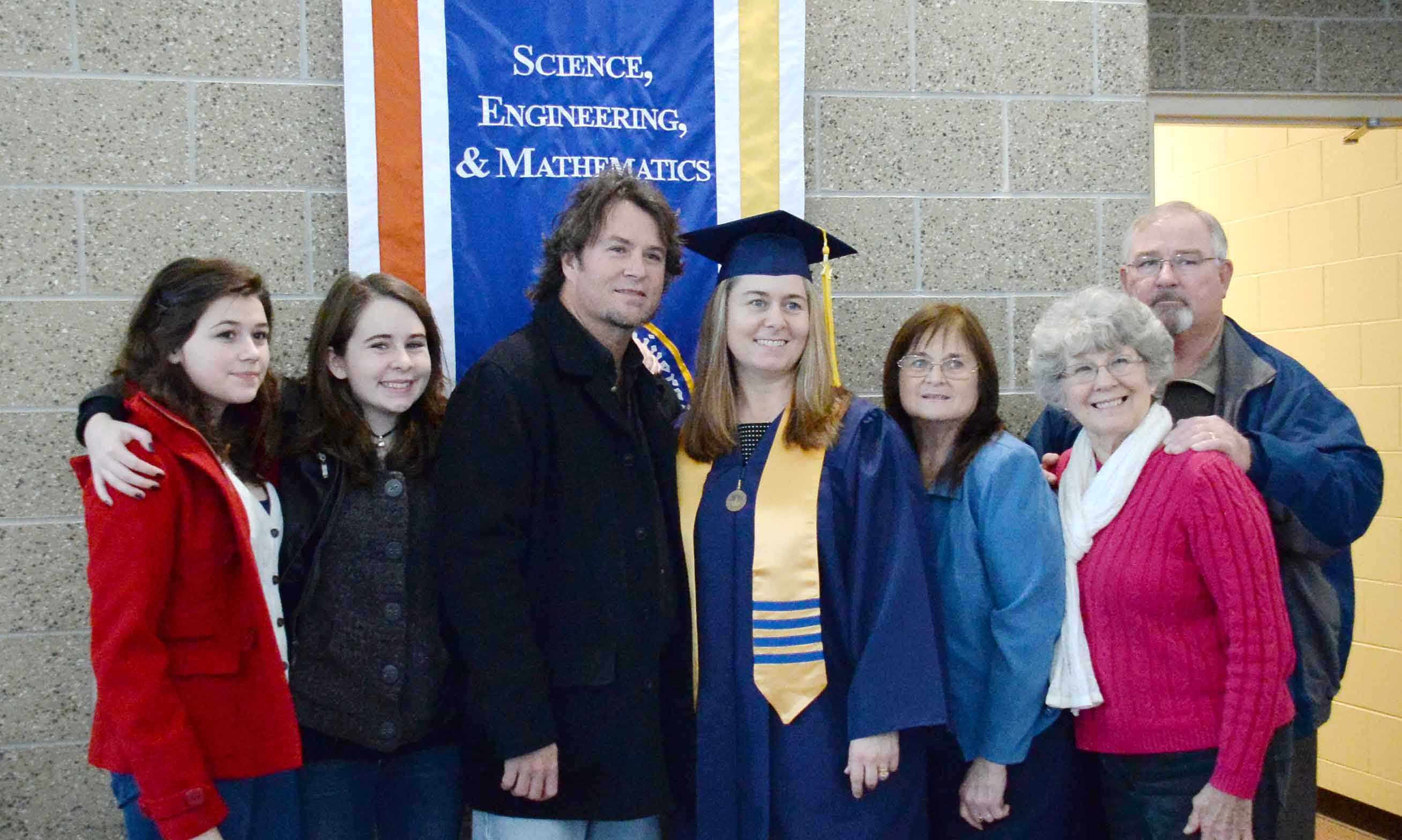 Parents and Family with their Vincennes University graduate in cap and gown